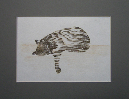 Sleeping cat woodcut